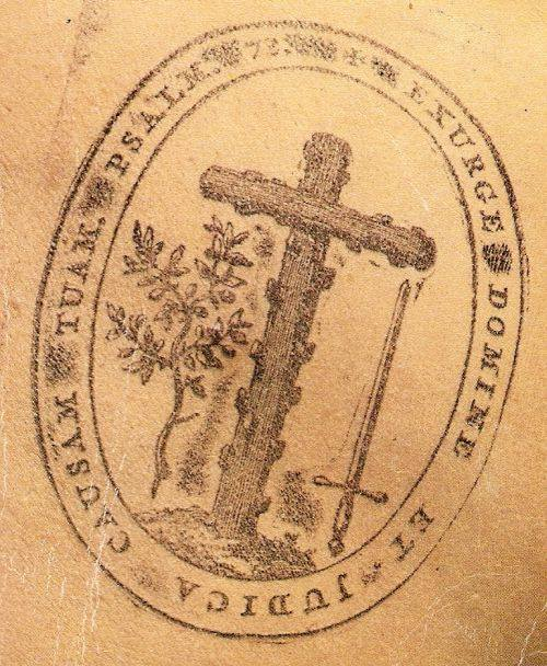 """La croce nodosa, la spada e l'ulivo e le parole intorno """"EXURGE DOMINE ET JUDICA CAUSAM TUAM"""" costituiscono il simbolo dell'Inquisizione."""