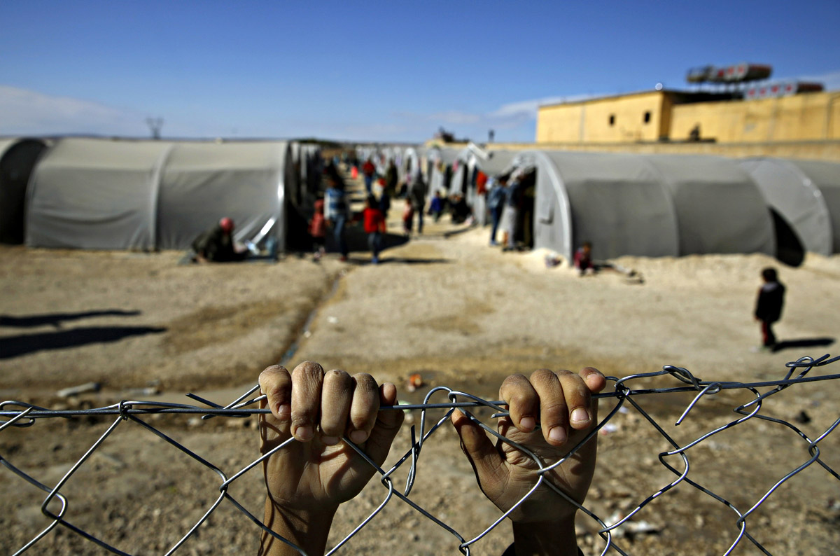 """ATTENTION EDITORS - REUTERS PICTURE HIGHLIGHT TRANSMITTED BY 1345 GMT ON NOVEMBER 3, 2014 YAN02 A Kurdish refugee boy from the Syrian town of Kobani holds onto a fence that surrounds a refugee camp in the border town of Suruc, Sanliurfa province November 3, 2014. REUTERS/Yannis Behrakis REUTERS NEWS PICTURES HAS NOW MADE IT EASIER TO FIND THE BEST PHOTOS FROM THE MOST IMPORTANT STORIES AND TOP STANDALONES EACH DAY. Search for """"TPX"""" in the IPTC Supplemental Category field or """"IMAGES OF THE DAY"""" in the Caption field and you will find a selection of 80-100 of our daily Top Pictures. REUTERS NEWS PICTURES. TEMPLATE OUT MIDEAST-CRISIS/"""